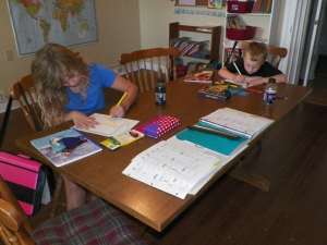 Concentrating on writing and then drawing pictures of themselves.
